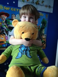Boy and Pooh Bear