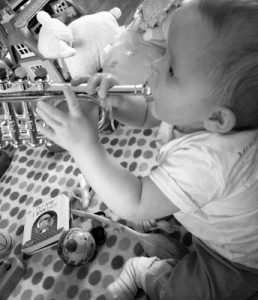 Baby Playing the Trumpet